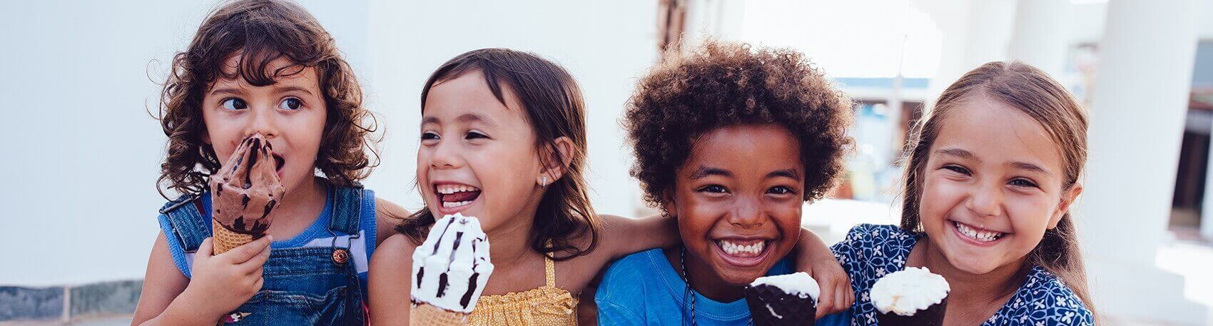 group of children eating ice cream together